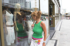 Window shopping. Prett blond girl window shopping Royalty Free Stock Image