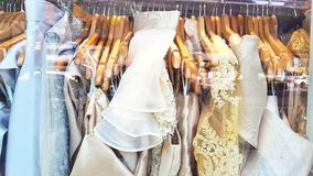 Window shopping of dress. A look of dress through the window Stock Image