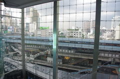 Window of a shopping mall in Bangkok. Looking through the window of a modern shopping mall in Bangkok with a view of Skytrain station Stock Image
