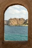 Window showing coastline. And hills rising in the back Stock Image