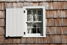 Window and Shutter. An old window with a shutter for protection Royalty Free Stock Photography
