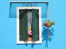 Window with shutter and flowers Royalty Free Stock Images