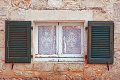 Window with shutter and net curtain Royalty Free Stock Photography
