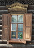 Window with shutters. Facade`s decor from wood. Russian Siberian old art of building. Architecture element Royalty Free Stock Photos