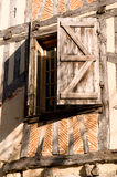 Window Shutters. Symmetrical window shutters on a french home Royalty Free Stock Photo