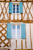 Window Shutters. Symmetrical window shutters on a french home Stock Images