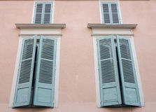 Window Shutters. Symmetrical window shutters on a french home Royalty Free Stock Photos
