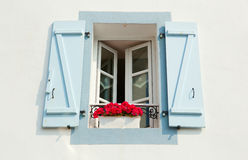 Window with shutters. And flowers Stock Photos
