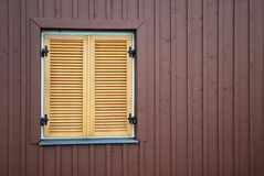 Window with shutters. A single window with closed wooden shutters Stock Photo