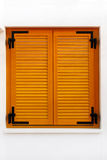 Window shutters. Retro wooden window shutters on white wall Royalty Free Stock Photography