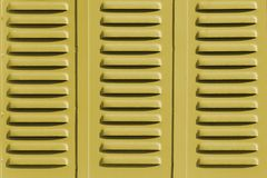 Window Shutters Background. Yellow shutters closed , background detail Stock Image