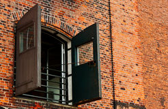 Window with shutters on brick background Royalty Free Stock Photo