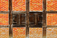 Window with shutters in brick wall of half timbered house Stock Photo