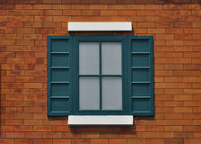 Exterior shutters and windows on brickwall Stock Image