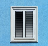 Window with shutters closeup view, sunny day on sea resort Royalty Free Stock Photos