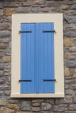 Window with shutters. Window with colorful shutters on the opal coast in northern France royalty free stock photo