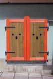 Window shutters. Elegant wooden window shutters closed Royalty Free Stock Image