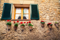 Window with shutters and flower pots Royalty Free Stock Image