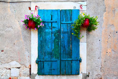 Window with shutters and flowerpots Stock Image