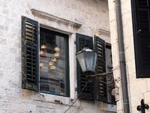 Window Shutters on Historical Stone Building, Kotor Old Town, Montenegro. Detail of an historical original building, constructed with local pale grey stone royalty free stock photo