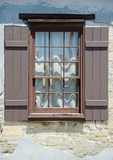 Window with shutters in medieval european village Stock Photos