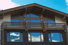Window shutters of mountain chalet Stock Images