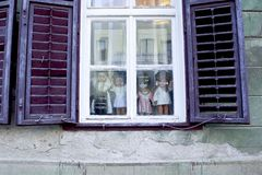 Window with shutters. Nice window with shutters and dolls Royalty Free Stock Photos