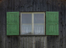 The window with shutters of an old building.  Stock Photography