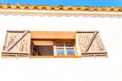 Window shutters on an old european style building, architectural Stock Photo