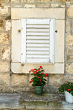 The window with shutters of the old house Royalty Free Stock Photography