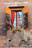 Window with shutters in old house in Bologna, Italy Royalty Free Stock Photography