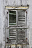 Window Shutters on Old Weathered Wooden House Royalty Free Stock Images