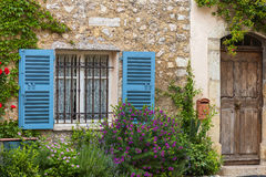Window with shutters and old wooden door. Traditional house Royalty Free Stock Photos