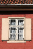 Window with shutters in an old wooden house Stock Images