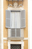 Window with shutters on a residential house in Rome, Italy Stock Photo