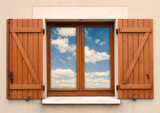 Window and shutters and sky.  Royalty Free Stock Images
