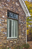 Window Shutters and Stone Facade Stock Image
