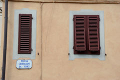 Window shutters in Vinci city in Tuscany, Italy. Royalty Free Stock Photo