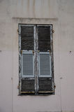 Window with shutters. Wall fragment of historical building in old town in Nice, France. Window with wooden shutters Stock Image