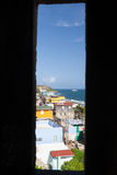 Window sight. Colorful sight trough medieval north-side watch tower window in old San Juan, Puerto Rico facing Caribbean sea Royalty Free Stock Images