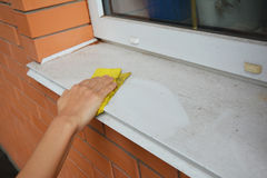 Window Sill Cleaning. Cleaning Your Windows and Window Sills. Cleaning Your Windows and Window Sills Stock Images