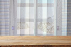 window sill and curtains in front of winter snow landscape Royalty Free Stock Photos