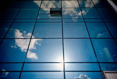 Window in sky. Shop window, reflection the blue sky and white clouds Stock Photography