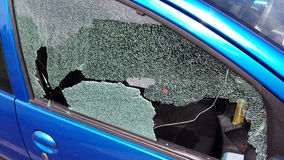Window smashed on car. Thief smashed the window of a car Stock Photo