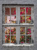 Window, snowfall and christmas tree Stock Image