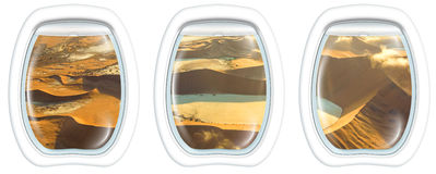 Window on Sossusvlei Desert. Three plane windows on Deadvlei, Sossusvlei desert in Namib Naukluft National Park, Namibia, from a plane on the porthole windows Stock Photos