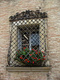 Window with stained glass in an old Italian house. Stock Photo
