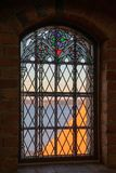 Window with stained glass in teh chapel of Trakai Island Castle stock images