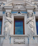Window with statues Royalty Free Stock Images