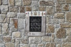 Window of a stone building with mosaic ornaments Royalty Free Stock Photography